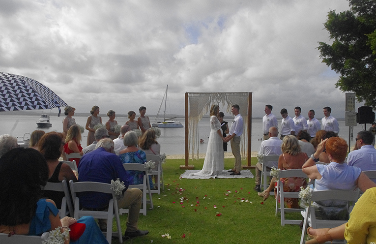 The Bride and Groom exchanging their vows. Photo by Marian Sampson.