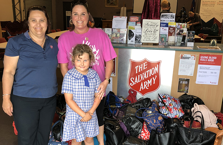 'IT'S IN THE BAG': Organiser Jodie Genner and daughter Rhani deliver 180 handbags to Salvation Army in Raymond Terrace.