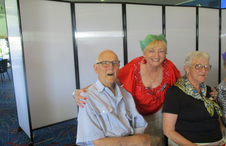 Edith Sneyd welcomes past presidents Bruce and Barbara Edwards.  Photo by Lynn Moffit.