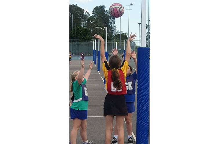 Stage 3 students playing netball at the Gala Day.