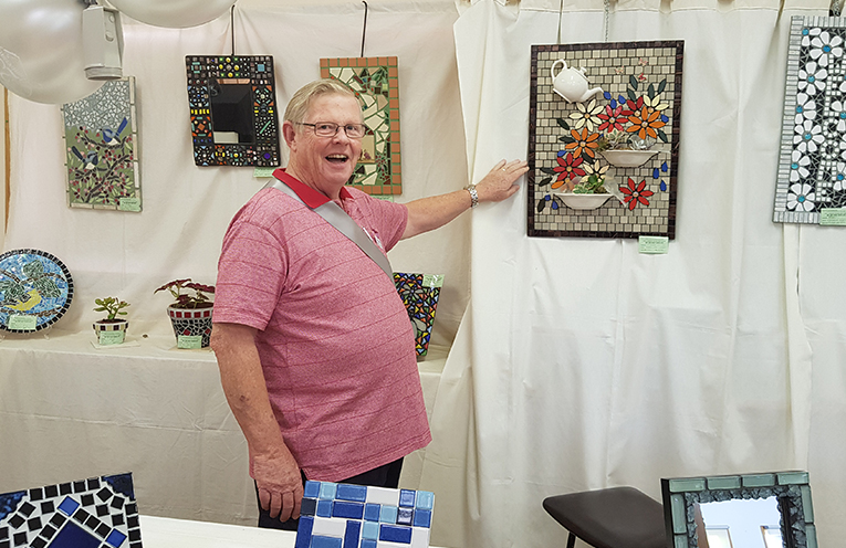 3 DAY ART AND CRAFT SHOW: Graham Bell admires the mosaics.
