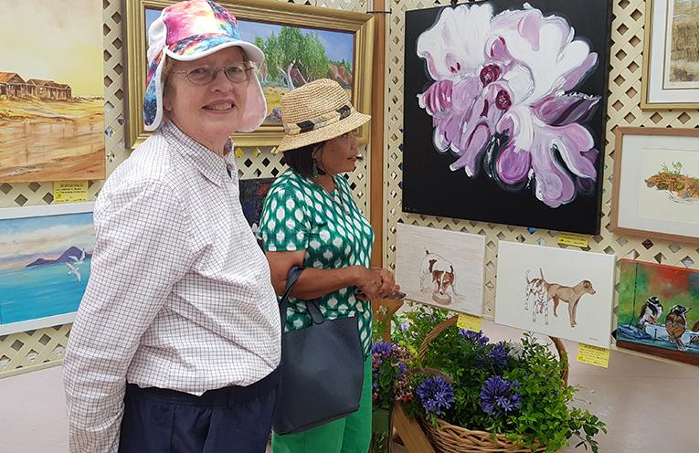 ART SHOW VISITORS: Betty Reid and Maggie Buchanan.