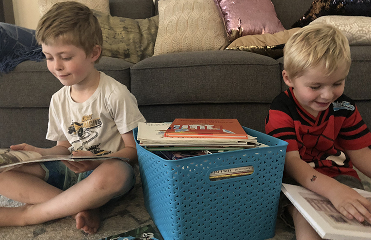 Jaxon and Lucas Pickett enjoying the opportunity to read