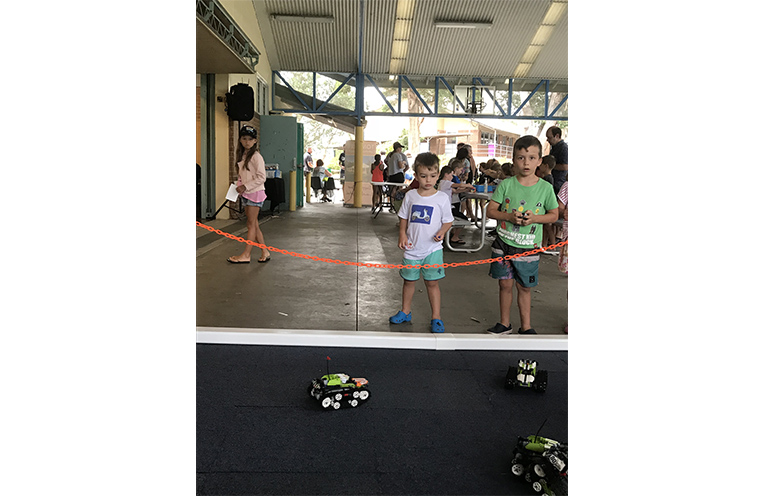 Leo and Zachary Portelli enjoying the remote control Lego cars. Photo by Marian Sampson.