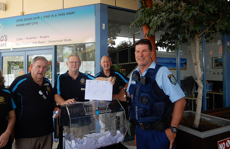 ROTARY RAFFLE: Rotary's Peter Sivyer, Graham Bell, Paul Dewar and Snr Constable Dave Coyle.