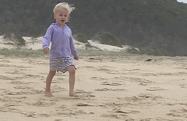 Ava Maree O'Brien enjoying a cloudy and windy afternoon on Fingal Beach with her family. Photos by Marian Sampson.