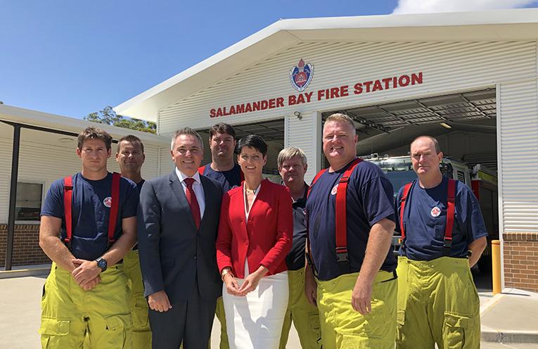Kate Washington and Guy Zangari with local firefighters.