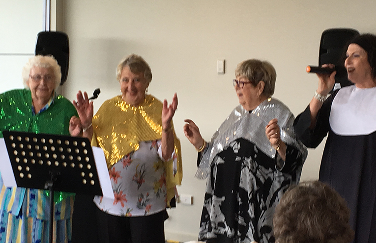 Nelson Bay Ladies Probus Club Members helping Jenni Rossi sing from her Case of Memories Sister Paula Redgrove,  Jan Smith and Joy Doyle.