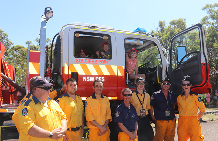 RFS Crew and local children on the RFS Fire Truck