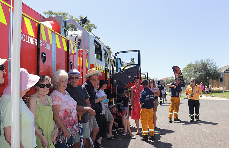 Community members with Port Stephens Member Kate Washington listening to the community information session.