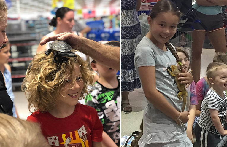 Nine year old Silas Mears of Raymond Terrace giggles as the turtle is placed on his head. (left) Eight year old Charlee Wattus of Medowie has a special love for reptiles. (right)