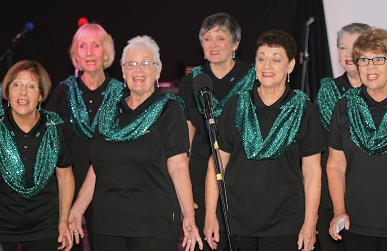 The singers of Hunter Women of Note Chorus enjoy singing together in a friendly environment.