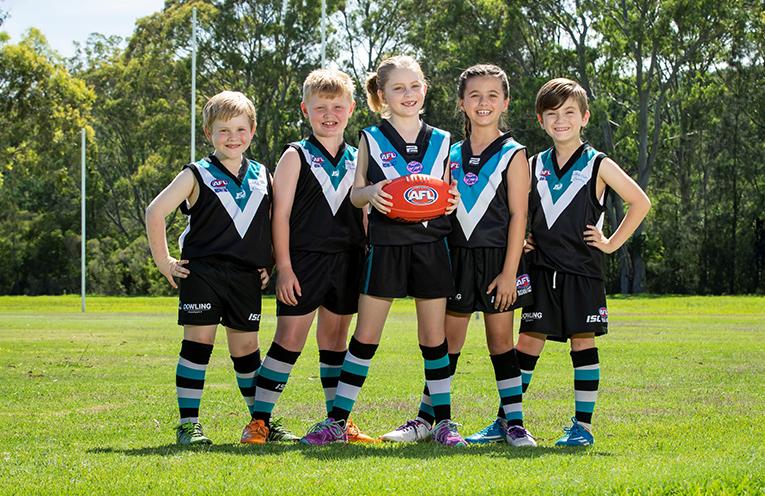 Port Stephens AFL Club players Dane McKimm, Tyson Hay, Scarlett Potter, Caitlyn Ashpole, and Jesse Bose.