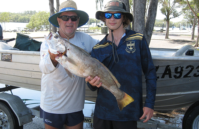 Craig and Brock with their jewfish at the Lemon Tree Passage boat ramp.