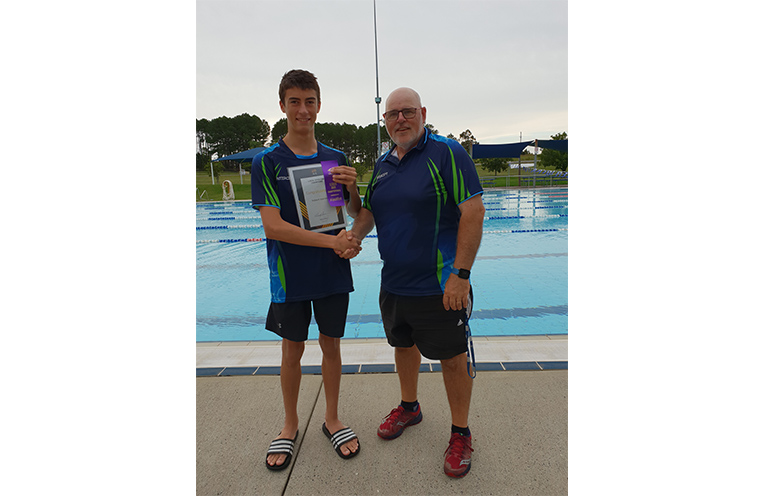 Coach Michael Abel and Robert Stanley with the State Age finalists ribbon and his AIS Local Champions Grant Certificate.