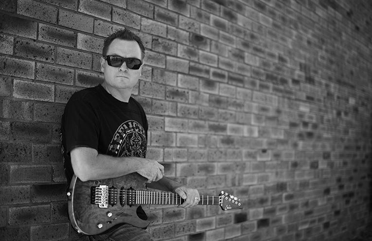 Bernie - solo guitar and vocalist.