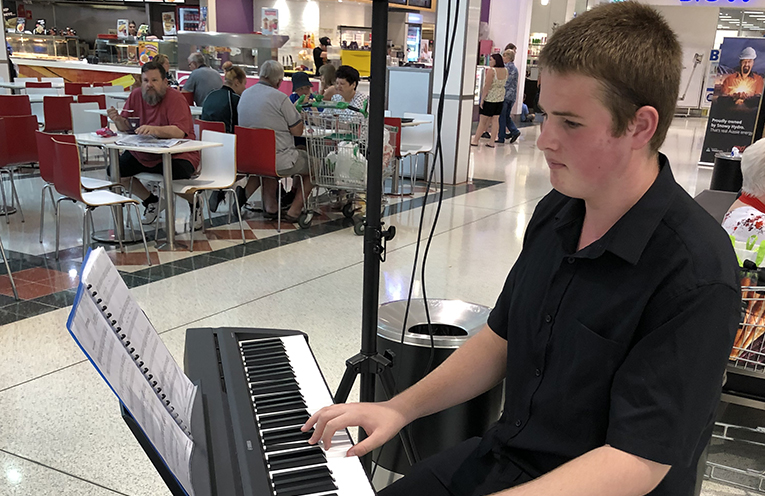 Alex Hall of Irrawang High School entertains shoppers at Marketplace Raymond Terrace on Valentine's day.