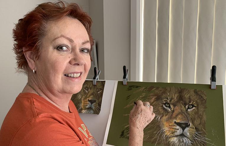 Artist Judy Warren at work.