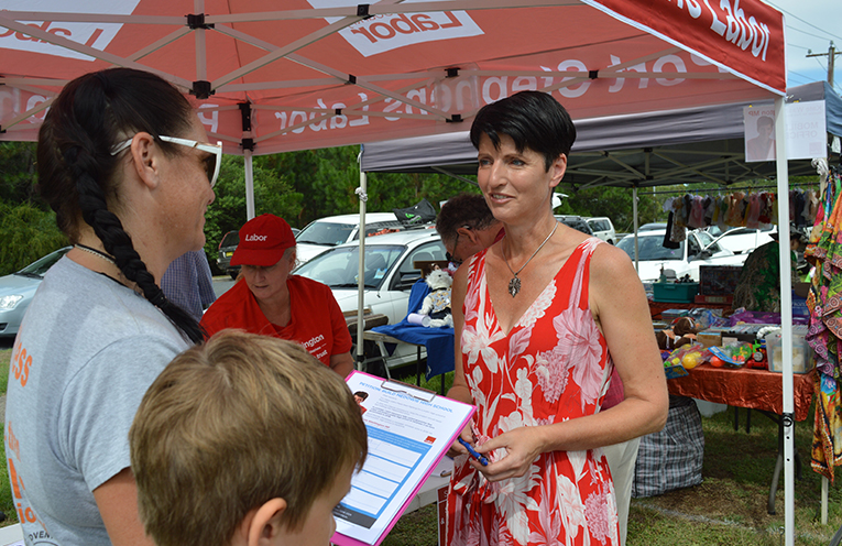 Kate Washington speaks to the electorate at one of her regular market mobile office posts.