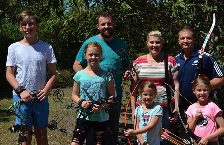 Port Stephens Archery Club Members Zachary Shorten, Madison Shorten, Skippy Shorten, Morgan Richards, Karen Richards (rear), Steve Richards and Abigael Richard. ready to take aim.