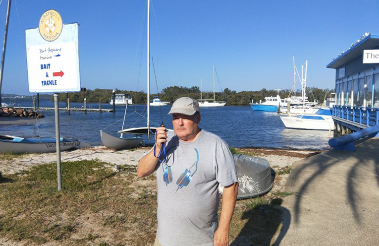 Club member Leigh (VK2KY) testing reception from the new Gan Gan repeater dish with a handset at the Lemon Tree Passage.