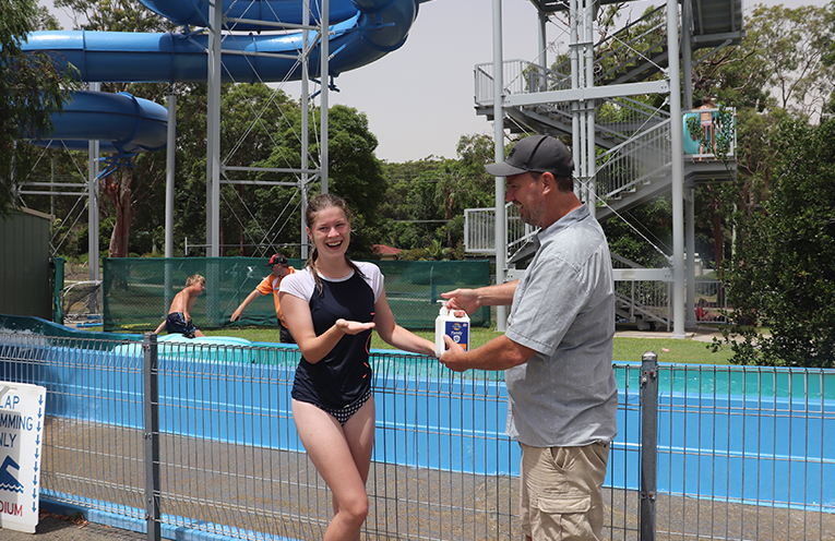 2.Tatum Hunt with Mark Landa being sunsmart at the Tomaree High School Swimming Carnival. Photo by Marian Sampson.