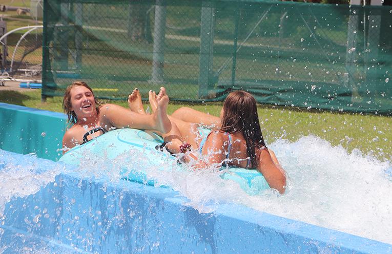 3.Seth Beckington and Logan Fisher enjoying the water slide. Photo by Marian Sampson.