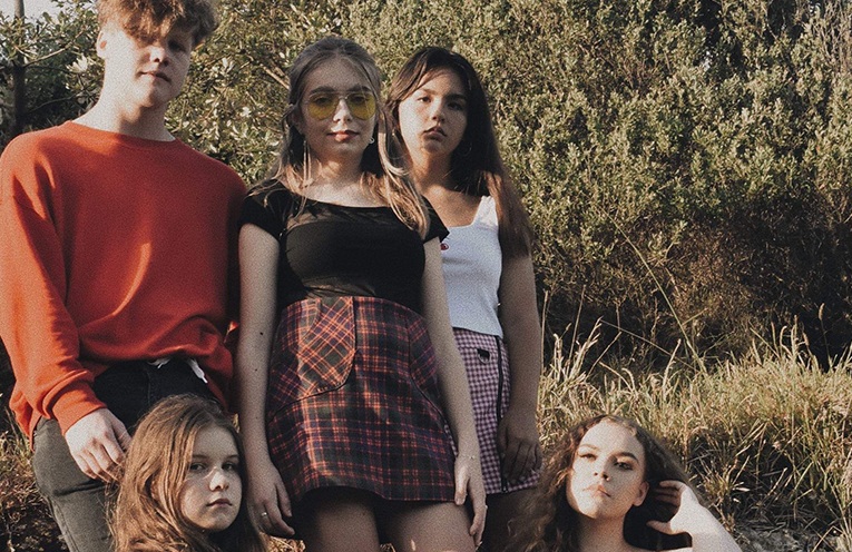 Ellipsis, the band: Will Mackenzie, Lulu Graham, and Athena Christiansen (standing) with Lilly Sullivan and Grace Neal.