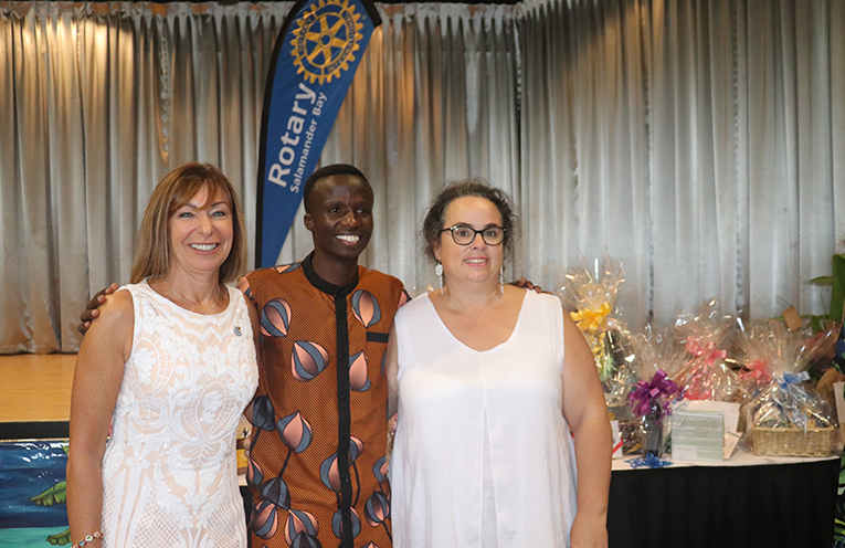Rotary Club of Salamander Bay President Ina George, St Judes Graduate Godwin Silayo and St Judes Founder Gemma Sisa. Photo by Marian Sampson.