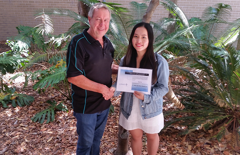 Dan Vu achieved the highest ATAR with a result of 96.55 in 2018 and was named Dux of the year at Tomaree High School. She is pictured receiving the Port Stephens Legacy Group Alan Hudson OAM and Bart Richard OAM Certificate of Achievement from PSLG Chairman, Doug Jacka, together with a cheque to assist in her further education at University of Sydney.