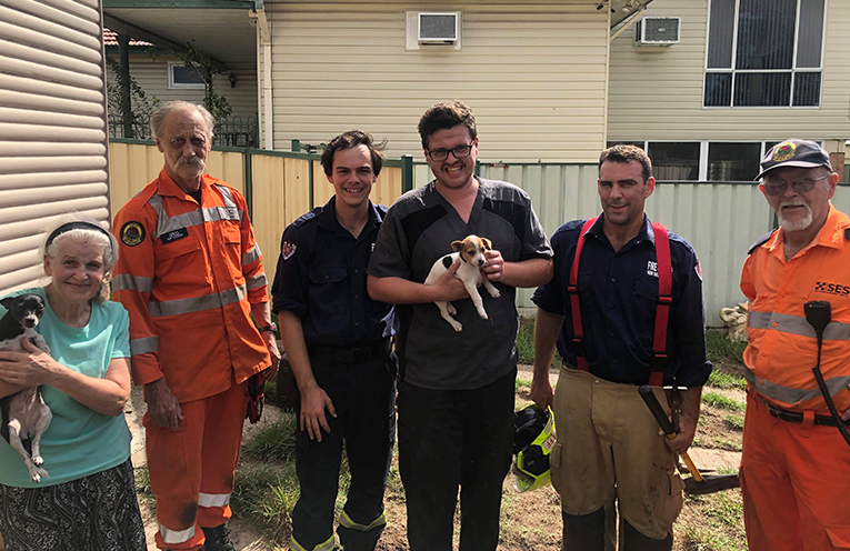 The rescue team with the pesky pup (centre), safe and well.