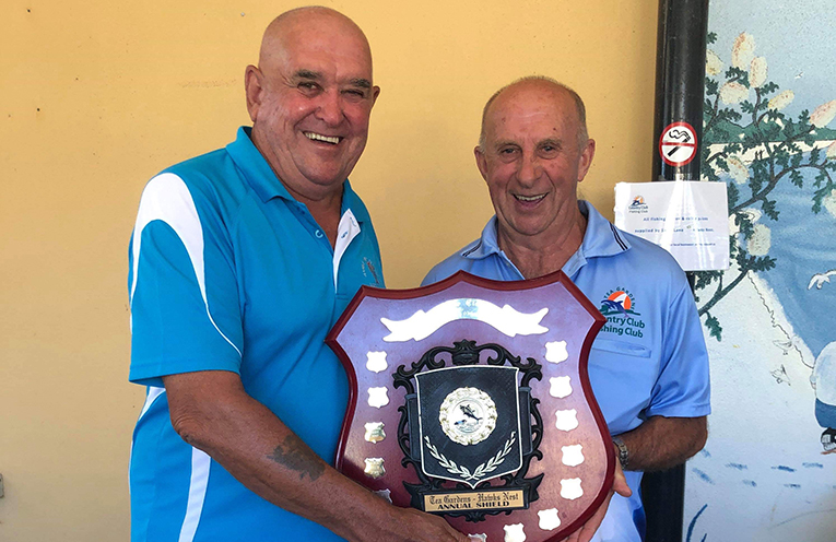 Jim McDonald President-HN and John Vaughan President-TG holding the much contested shield.