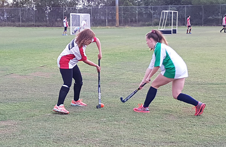 Claire Hendley and Maisie O'Connell training under the fee rebate with the Nelson Bay Hockey Club.