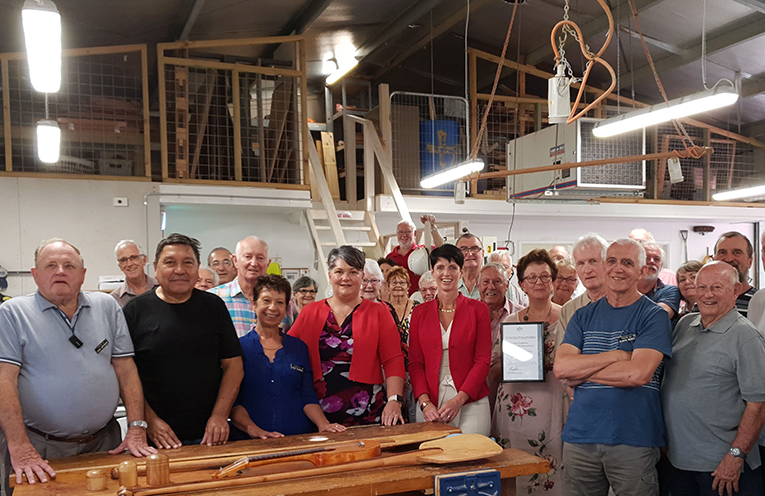 Member for Paterson Meryl Swanson, Kate Washington Member for Port Stephens with members of the Port Stephens Community Arts Centre at the Official Opening of the Woodworkers Shed.