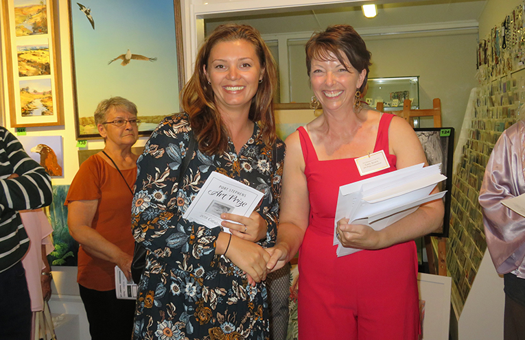 Kimberley Swan receiving second place in Section A. Travel - Colour and Wonder for her work  New Zealand Tui Bird - part of the prize is a two week exhibition in Maitland's The Levee Gallery.