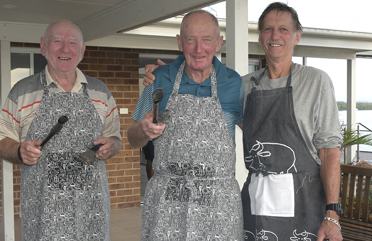 Probus Club of Port Stephens members George Hammond, John Townsend, Russel Williams cooking up a storm for the travellers.
