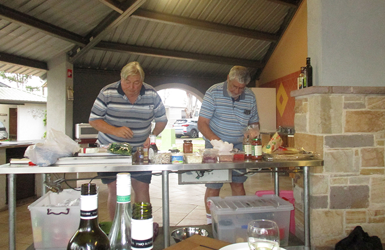 Fingal Bay Probus Club's  master chefs: Roy Jeffery and Ross Jennings gathering all the ingredients for a farewell  pizza feast.