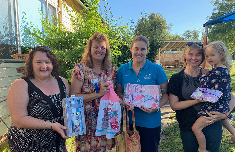 Kylie Paar, Belinda Moore, Stacey McLoughlin, Kim Kent and Ella Kent, receiving donations from the CWA for the stall 2019 Mother's Day Stall.