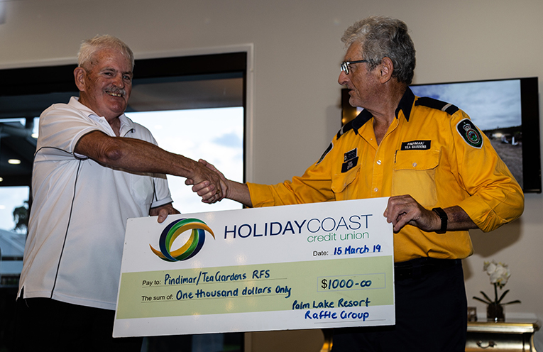 PALM LAKE RESORT DONATION: Rod Larkin and Noel Quince.