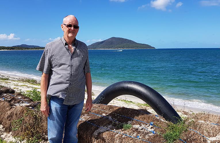 WINDA WOPPA ASSOCIATION: Ken Garrard with one of the sand pumps on Jimmy's Beach.