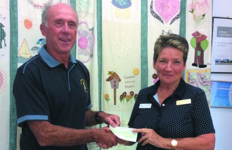 MYALL COAST ART AND CRAFT CLUB DONATION: Surf Club President Tony Logue and MCACC President Sue Burns.