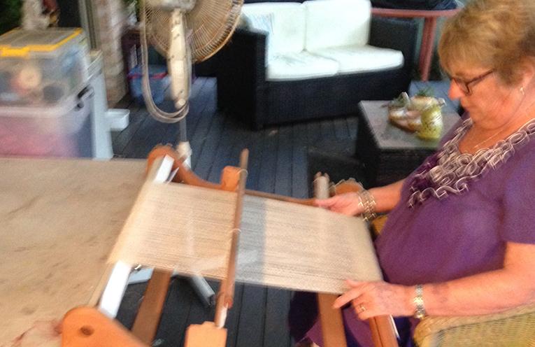 Tanilba Bay local Fay Kelly at her weaving loom.