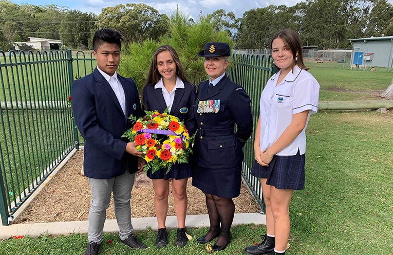School Captains Dan Villamanca and Katerina Nicolopoulos, with RAAF Flight Lieutenant Donna Watts-Endresz and Madi Munro who was the student speaker at the school's ANZAC Day ceremony.