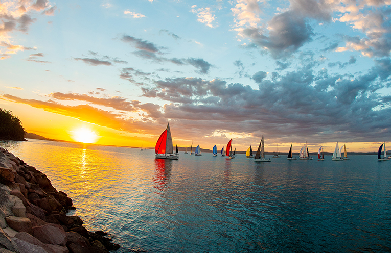The Sail Port Stephens Regatta making their way down the bay under spinnakers. Photo by Bonita Holmes-Nu'u