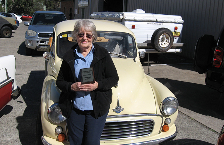 Judy Camm with her Morris Minor sporting one of her trophies.
