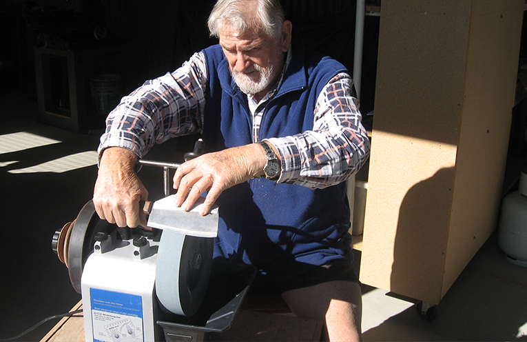 Ken Boyd and his state-of-the-art knife sharpener.