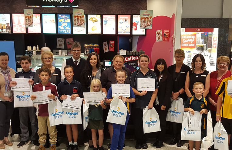 This weeks PBL award winners with school staff and the team from Marketplace Raymond Terrace.