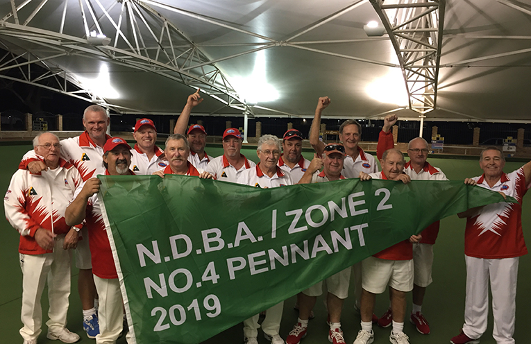The victorious Karuah bowlers with their spoils, the NDBA Pennant.