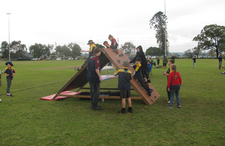 The Scouts using some of their equipment which they purchase through fundraising activities like Bob a Job.