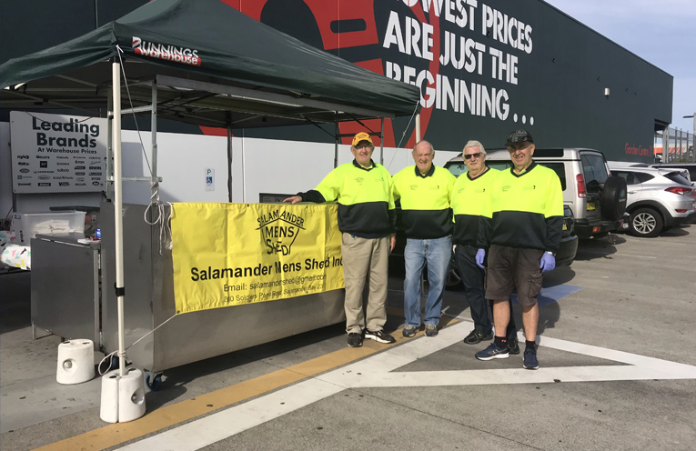 Salamander Bay Men Shed President Jim Eves, with members Rex Gilby, Joe McAuley and Paul Jupp raising funds for the Men's Shed at Bunnings Taylors Beach. Photo by Marian Sampson.